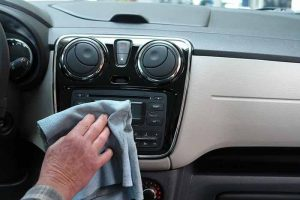 Wipe down the dashboard before vacuuming